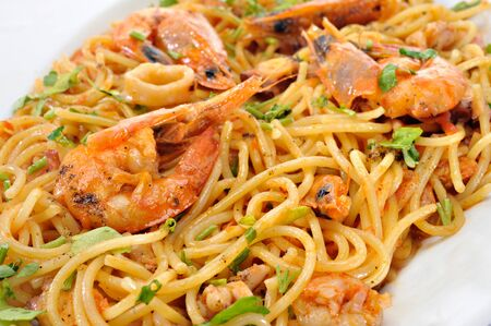 Pastas with shrimps and squids Stock Photo