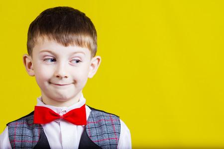 Happy,excited joyful little boy with rolling eyes . Closeup portrait