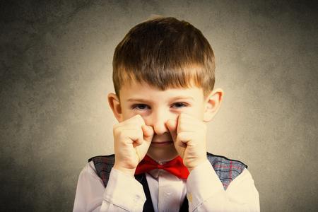 stubborn: Stubborn,sad,upset  little boy,child  isolated over grey background.Facial expression