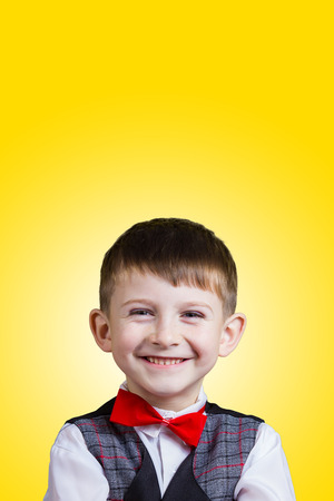 beautiful little boys: Smiling Happy Joyful beautiful little boy  looking at camera.Closeup Studio Portrait isolated on yellow background.