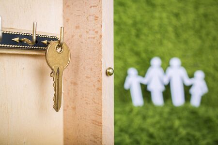 household money: Property insurance and security concept.Wooden Key Holder House with  isolated white background
