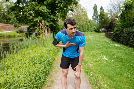 Man runner chest cramps after running. Jogging man with chest  pain after jogging work out.