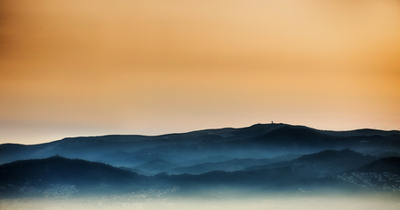 Sunset silhouette of hills in spain. Stock Photo