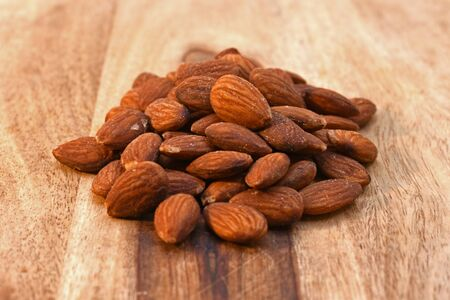 Salted almonds on a wood cutting board