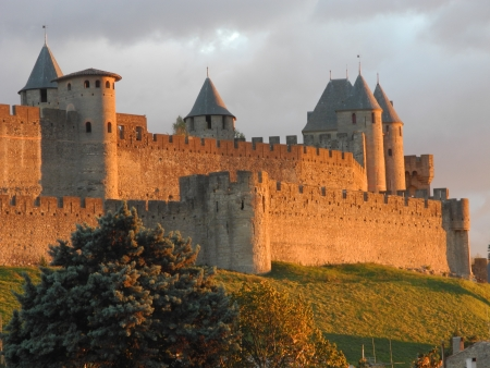 chateau: La Cite, Carcassonne, France  View of towers and walls at sunset