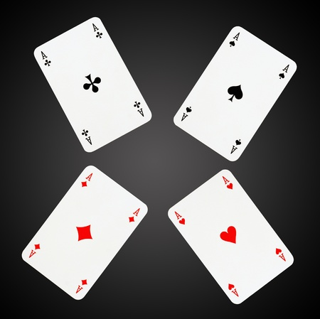 ace hearts: Aces playing cards isolated on black-gray background