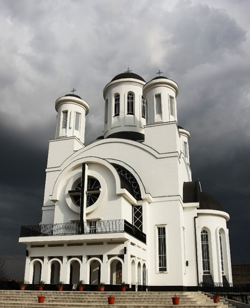 approaching: Withe christian church and approaching storm