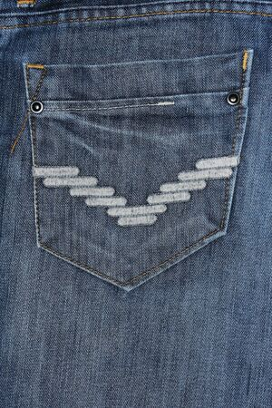 Closeup detail of  blue jeans pocket photo