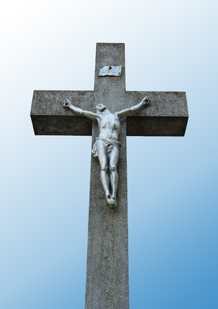 Statue of Jesus on a stone cross photo