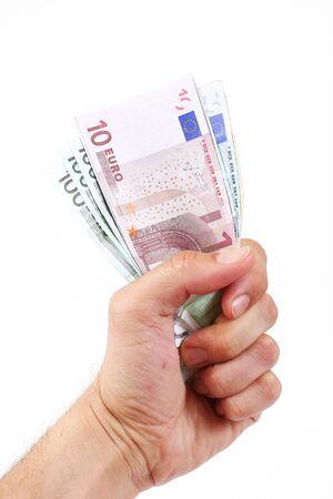 billets euros: Monétaire de l'euro tenant la main