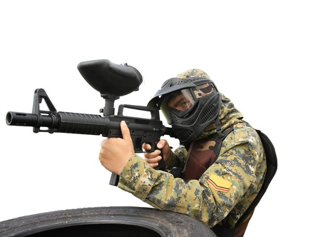 Paintball player isolated on white