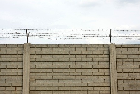 prison fence: Barbed wire fence
