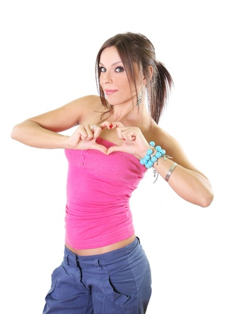 Cute girl making a heart shape sign with her hands Stock Photo