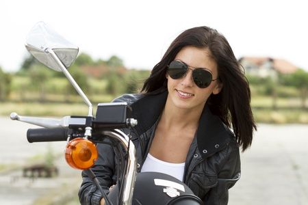 Beautiful biker girl portrait photo