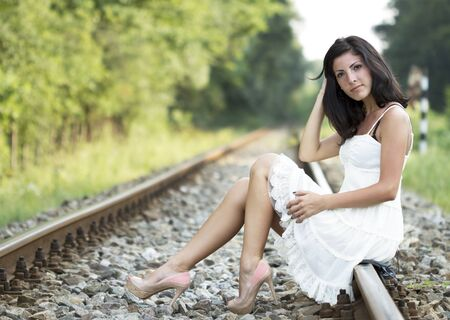 blurr: Cute young woman standing on a railroad Stock Photo