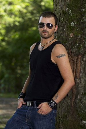 tattooed: Hansom young man in forest