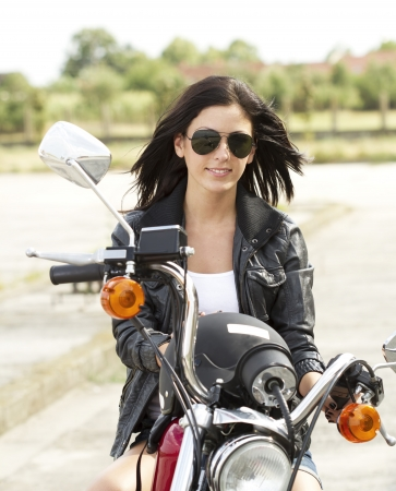 Cute Woman on a motorcycle Standard-Bild