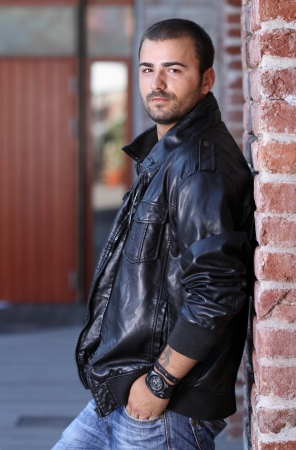 man with beard: Hansom man in thick leather jacket Stock Photo