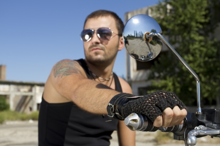 Good looking man holding a motorcycle handle photo