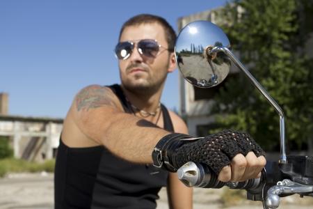 good looking man: Good looking man holding a motorcycle handle
