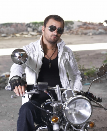 Hansom motorcycle rider with sunglasses photo