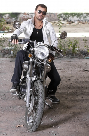 Good looking young man on motorcycle photo