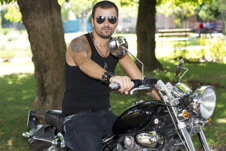 Rebel motorcycle rider on a chopper photo