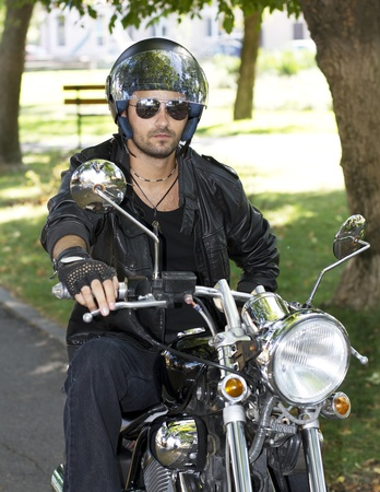 Motorcycle chopper rider with helmet photo