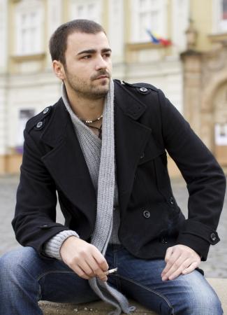 man smoking: Young man smoking Stock Photo