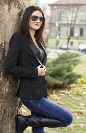 near: Sexy girl in a city park Stock Photo