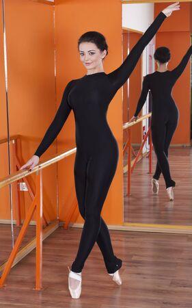 Pretty ballerina in training gym photo