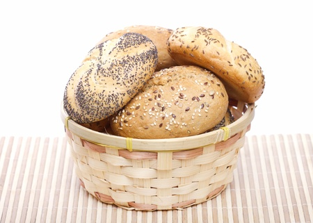 Traditional bread rolls in wicker basket photo