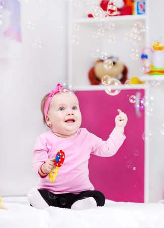 Baby girl playing bubbles soap  photo