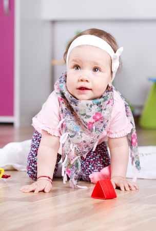 Adorable baby girl playing photo