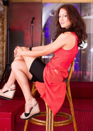 sexy girl sitting: Sexy girl sitting in the club Archivio Fotografico