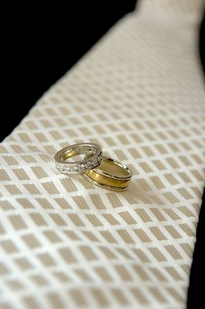 Wedding rings & wedding tie Stock Photo