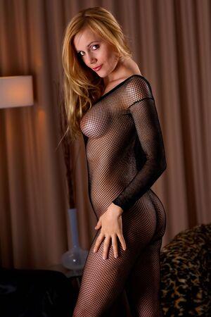 erotic girl: Sexy girl posing in black fishnet body-stocking
