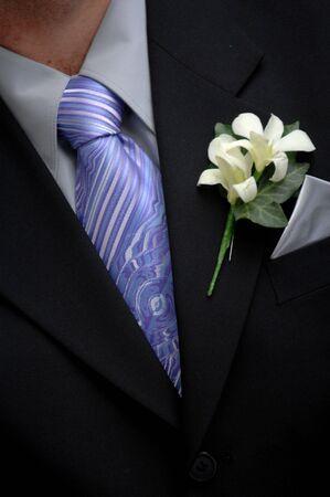 Groom wearing boutonniere Standard-Bild
