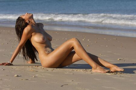 Nude beach girl Stock Photo