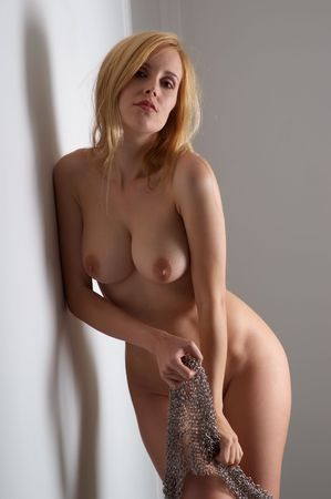 Sexy nude blonde woman stripping off chaindress Stock Photo - 4968035