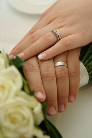 Bride & Groom wearing wedding rings  Stock Photo