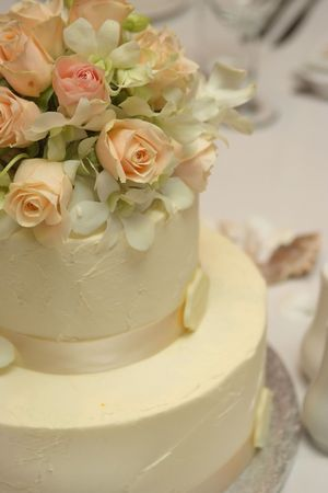 Flower decorated wedding cake photo