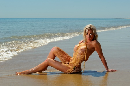 Sexy topless beach girl with fishing net Stock Photo - 11474291