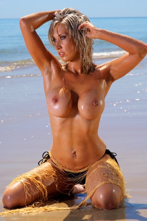 Sexy topless beach girl with fishing net  Stock Photo