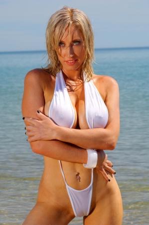Sexy beach girl in micro bikini Stock Photo - 11474292