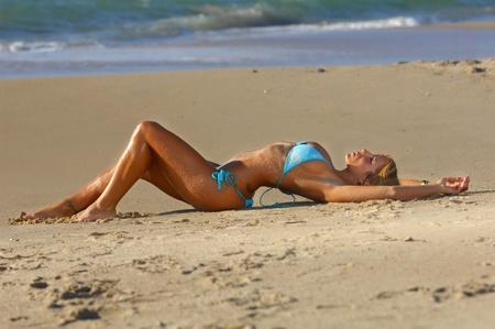 bikini sexy: Sexy beach bikini girl  Stock Photo