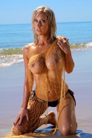 Sexy topless beach girl  Stock Photo - 12924702