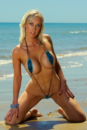provocative: Sexy beach girl in micro bikini