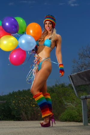 Sexy bikini girl with colorful balloons  photo