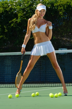Sexy tennis girl  Stock Photo - 13952300